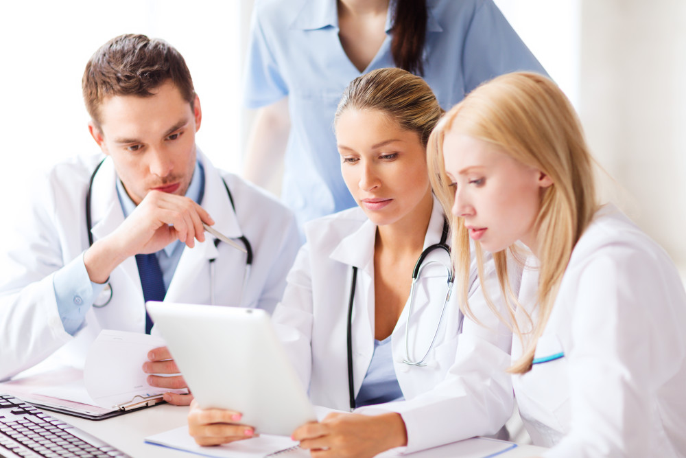 healthcare, medical and technology concept - group of doctors lo